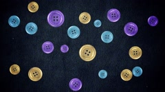 Colorful Buttons Moving on a Cloth in Stop Motion Style in Seamless Loop Stock Footage