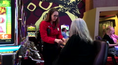 Motion of worker counting money for winner inside Hard Rock Casino Stock Footage