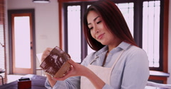 Asian woman holding ceramic piece Stock Footage
