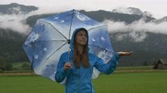 A sad woman wait when the rain stops Stock Footage