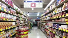 Food, coffee and tea beverage corridor in London drugs store Stock Footage