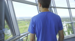 Man walk inside tower with view on landscape 4K Stock Footage