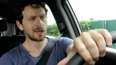 Funny geeky man in summer dancing in car while driving closeup 4K Stock Footage