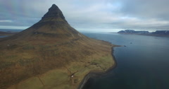 Aerial shot flying by Kirkjufell Mountain Stock Footage