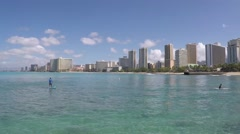 Aerial reveal of Hawaii skyline with paddle boarders. Stock Footage
