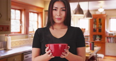 Japanese woman holding a hot bowl of soup Stock Footage