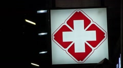 Hospital outpatient clinic of the red cross light box at night Stock Footage