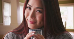 Closeup of Japanese woman holding a cup of tea Stock Footage