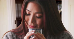 Chinese woman smelling her cup of tea Stock Footage