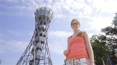 Woman posing under big Vinarium tower 4K Stock Footage