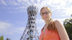 Woman portrait shot under tall Vinarium tower 4K Stock Footage