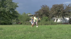 Man And Little Kid Have Fun With Football Or Soccer Ball In Slow Motion Stock Footage