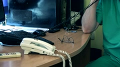 Ambulance doctors on the phone Stock Footage