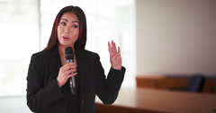 Japanese businesswoman talking in a meeting Stock Footage
