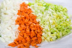 Preparation for soup with carrots, onions and celery - stock photo