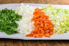 Preparation for soup with carrots, onions and celery Stock Photos