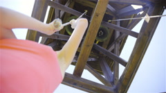 Ringing a bell inside wooden tower low angle 4K Stock Footage