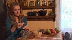 Young herbalist woman prepare oregano marjoram herbs for winter time. 4K Stock Footage