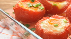 Delicious baked stuffed tomatoes with eggs and vegetables Stock Footage