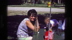 1957: Family picnic table coca cola soda glass beverage bottles Gallon of Coke.  Stock Footage