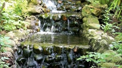 Decoration waterfall over stone, garden design, background Stock Footage