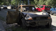 Burned car. the interior of an car damaged. From front Stock Footage