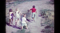 1957: Kids informal bragging rights style foot race on dirt road country rural. Stock Footage