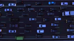 Cars driving slowly in traffic jam on highway at dusk aerial view. Stock Footage