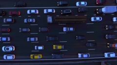 Aerial, flight over slow flow of cars in traffic jam on highway at night. Stock Footage