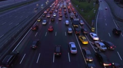 Aerial, flight over slow flow of cars in traffic jam on highway at night. - stock footage