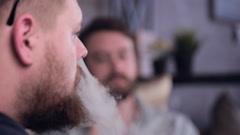 Two men smoking electronic smoking electronic cigarette. Smoke, fume Stock Footage