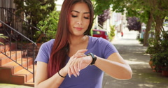 Japanese woman checking her steps on health tracker Stock Footage