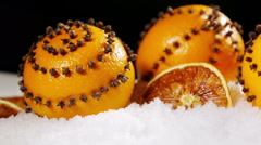 Dried orange slices and oranges with cloves Stock Footage
