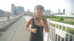 Beautiful healthy Japanese model running Osaka sky building backgrund lifestyle Stock Footage
