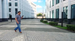 City style. Handsome adult man in casual wear using mobile phone coffee in fr Stock Footage