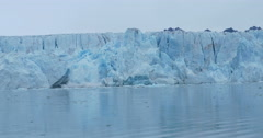 Glacier collapses and falls in to the water in the North Pole Stock Footage