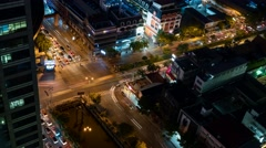 Aerial night traffic time lapse at an intersection in downtown Bangkok, Thailand Stock Footage