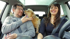 Man being licked in face by dog in car slow motion Stock Footage
