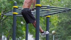 Athletic man doing gymnastics elements in City Park Stock Footage