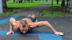 Athletic man doing gymnastics elements in City Park. workout Stock Footage