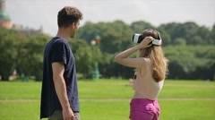 Young happy couple with virtual reality glasses. They getting VR experience  Stock Footage