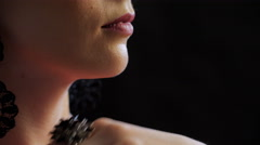 Young womans lips, chin, neck and hand with ring as big black flower, close-up Stock Footage