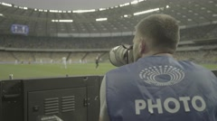Photographer photographing in the stadium during the match Stock Footage