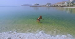 Sexy Woman at the Dead Sea Stock Footage