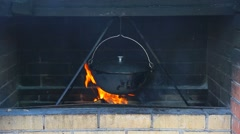 Cooking Food on An Open Fire in Cauldron Stock Footage