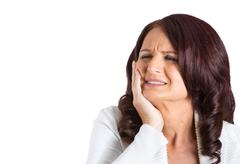 Woman with sensitive tooth ache Stock Photos