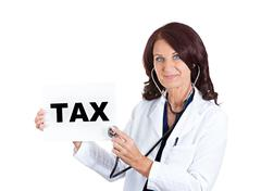 Female doctor listening with stethoscope tax sign Stock Photos