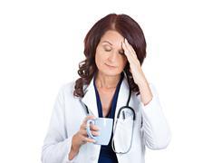 Sad unhappy sleepy female health care professional Stock Photos