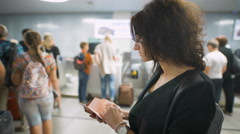 A beautiful lady is checking her passport before the trip Stock Footage