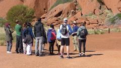 Uluru, Australia. Group of Tourists Tour Stock Footage